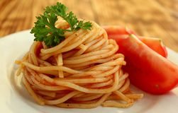 Italian pastas with tomato and sauce swirled in a spiral stock images