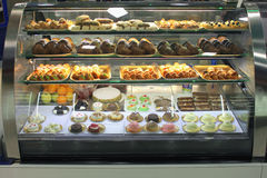 Italian pastry shop with different baba, donuts, jelly, ice cream, cakes with fruits and berries. Stock Photography