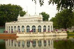 The Italian Pavillion in the gardens of the old Royal Summer Palace in Bang Pa In, Ayuttaya province, Thailand. Bang Pa-In Aisawan, artificial lake with bridge Royalty Free Stock Image