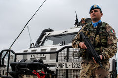 Italian peacekeeper soldiers in lebanon. Two italian soldier in Lebanon as UN peacekeeper uniform and arx rifle Stock Images