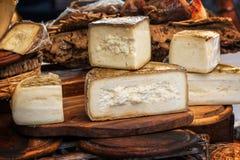 Italian pecorino cheese on a wood rustic display. Italian pecorino cheese on a wooden rustic display Stock Photography