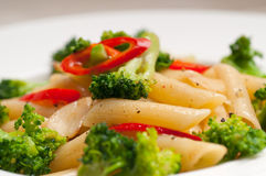 Italian penne pasta with broccoli and chili pepper stock photos