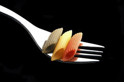 Italian penne pasta on a fork Stock Photography