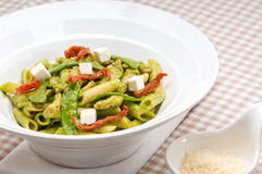 Italian penne pasta with sundried tomato and basil Royalty Free Stock Photos