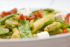 Italian penne pasta with sundried tomato and basil Stock Photo