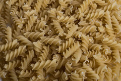 Italian Penne Rigate Macaroni Pasta raw food background or textu Stock Photography