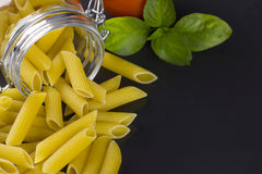 Italian Penne Rigate Macaroni Pasta with tomato and basil Stock Photography