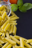 Italian Penne Rigate Macaroni Pasta with tomato and basil Stock Image