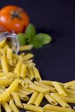 Italian Penne Rigate Macaroni Pasta with tomato and basil Royalty Free Stock Photography
