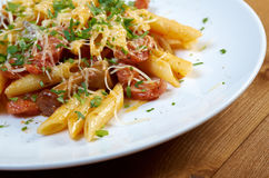 Italian Penne rigate pasta with Royalty Free Stock Photography