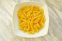 Italian penne. Italian traditional pasta on a dish Stock Image