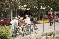 Italian people and foreigner travelers stop bicycle at riverside of passer river at Meran city. Italian people and foreigner travelers stop bicycle and walking Royalty Free Stock Photo
