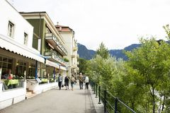 Italian people and foreigner travelers walking relax on footpath at riverside of passer river in Merano, Italy. Italian people and foreigner travelers walking stock photography