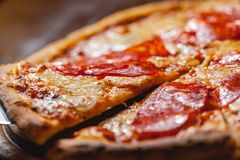 Italian Pepperoni pizza with mozzarella cheese and salami on wooden board. Close up royalty free stock images