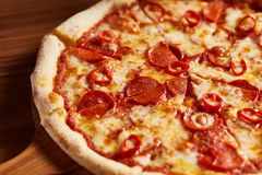 Italian Pepperoni Pizza. Italian Sliced Pepperoni Pizza Ready to Eat Stock Photos
