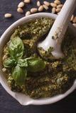 Italian pesto in a mortar macro. vertical top view Stock Photos