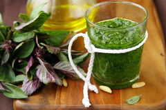 Italian pesto sauce. On a wooden board with basil Royalty Free Stock Image
