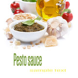 Italian pesto sauce and ingredients, close-up, isolated. On white Stock Image