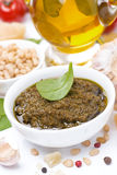 Italian pesto sauce and ingredients, close-up. Vertical Royalty Free Stock Photography