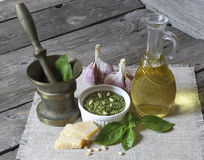 Italian pesto sauce and ingredients. On a dark wooden background Royalty Free Stock Photography