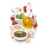 Italian pesto sauce and ingredients, isolated. On white Stock Photos
