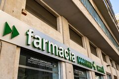 The Italian pharmacy farmacia in Italian written with a green font on a building in Palermo which provides 24-hour service