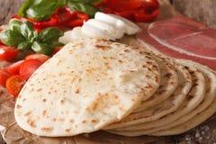 Italian piadina flat bread, ham, cheese and vegetables macro. ho Stock Photo