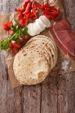 Italian piadina flatbread, ham, cheese and vegetables close-up. Royalty Free Stock Photos