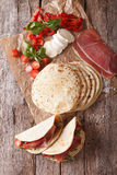 Italian piadina with ham, cheese and vegetables closeup. vertica Royalty Free Stock Image