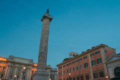 Italian Piazza Colonna with Roman Doric Column of Marcus Aurelius in Rome. Italian Piazza Colonna with Roman Doric Column of Marcus Aurelius in dusk Rome Royalty Free Stock Photo