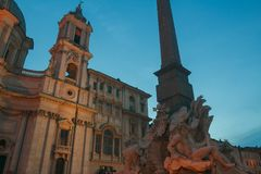 Italian Piazza Navona with Fountain of the Four Rivers and Sant Agnese church in Rome Stock Photo