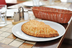 Italian pie calzone on a plate Stock Photography