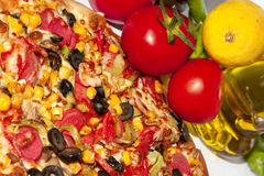 Italian Pizza. A quarter of delicious colorful Italian pizza with some ingredients royalty free stock photo