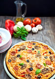 Italian pizza. Delicious pizza on old wood table with several ingredients Royalty Free Stock Photos