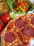 Italian pizza. A meal of italian pizza with sausage and cheese Royalty Free Stock Photos