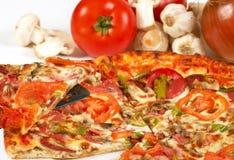Italian pizza. Tasty pizza close up on white, shallow dof royalty free stock photos