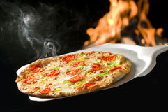 italian pizza baked in fire oven Stock Photography