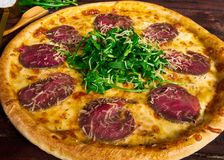 Italian pizza with beef close-up royalty free stock image