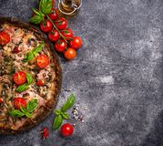 Italian pizza on black dough. Trendy food stock photo