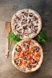 Italian pizza on a brown wooden background royalty free stock images