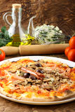 Italian Pizza Capricciosa. With mushrooms, sausage, olives and ham Stock Images