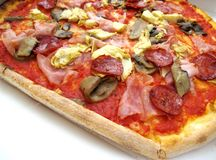 Italian pizza capricciosa. Closeup italian pizza capricciosa background Stock Photo