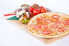 Italian pizza with cheese, tomatoes, olive, herbs Royalty Free Stock Images