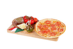 Italian pizza with cheese, tomatoes, olive, herbs, oregano, spic Stock Images