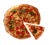 Italian pizza with cherry tomatoes and green basil Royalty Free Stock Photo