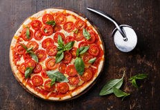 Italian pizza with cherry tomatoes Royalty Free Stock Photos