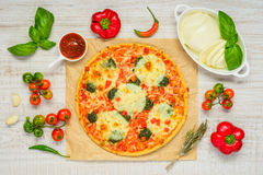 Italian Pizza with Cooking Ingredients and Vegetables Royalty Free Stock Images