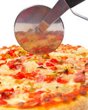 Italian pizza and cutter Stock Photos