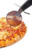 Italian pizza and cutter Royalty Free Stock Image