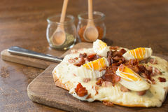 Italian pizza with egg and bacon. Italian pizza ontop with bacon and boiled egg stock image